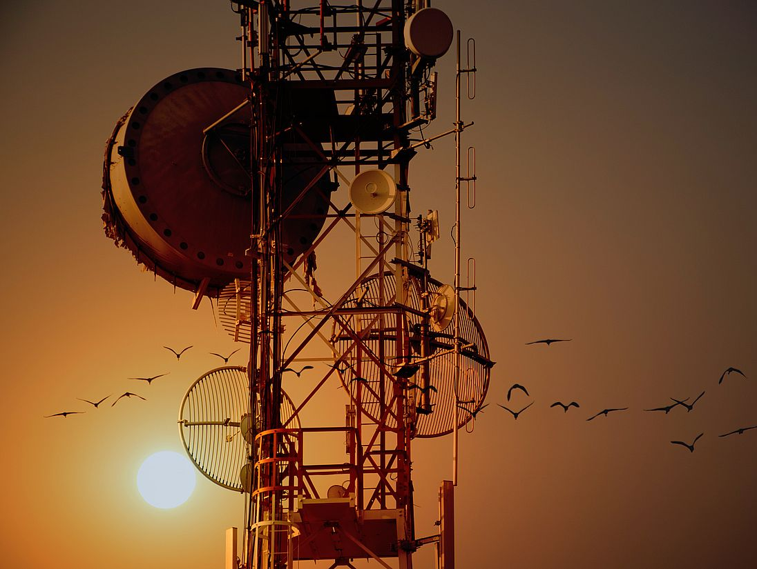 Telecommunication tower Antennas with sunset